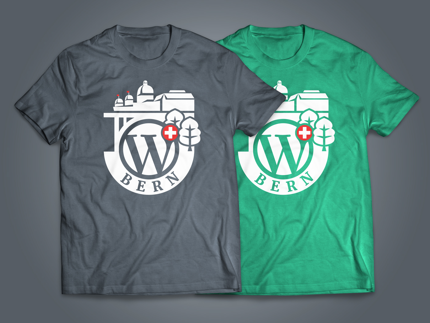 A grey and a green T-shirt with the WordCamp Bern logo on it